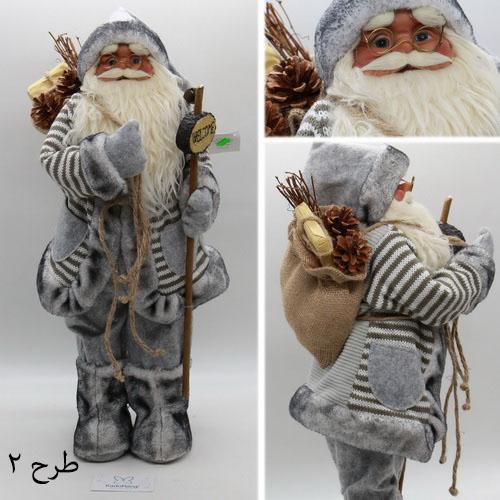 عروسک بابانوئل با قد متوسط و لباس طوسی