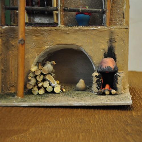 خانه سنتی نمایی از هیزم و دیگ